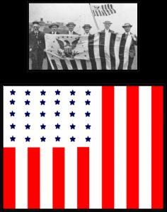 Men carrying flag with 13 vertical strips and eagle in main square area and an illustration of a flag with blue stars on white background with 13 vertical stripes