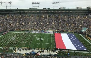 Footbal stadium with huge flag unfurled on field