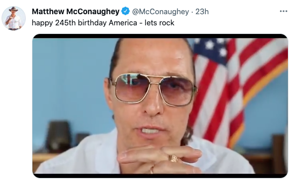 Matthew McConaughey speaks in front of gold-trimmed flag